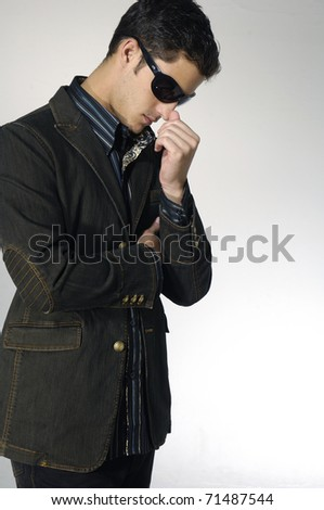 young Male model and sunglasses shot in studio - stock photo