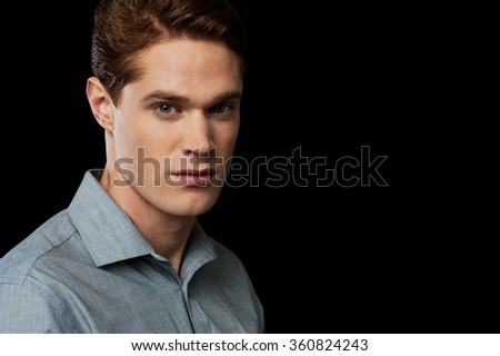 Young male model posing sideways