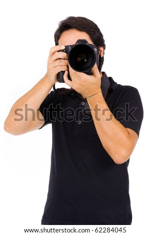 Young male photograher at studio, isolated on white
