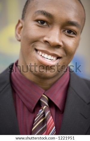 Young male professional smiling