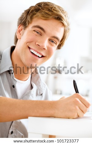 young male professional student is motivated studying at home