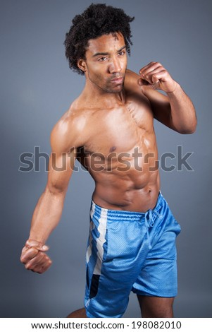 young male punching the screen  - stock photo