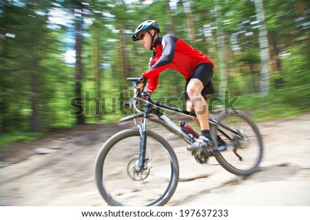 young male riding a mountain bike outdoor