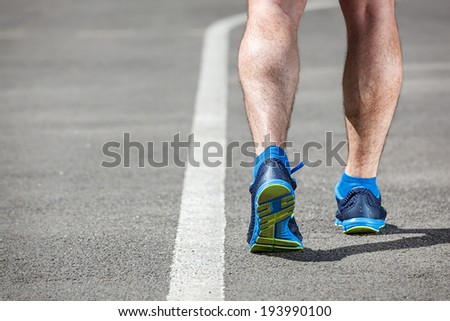 Young male runner getting ready to start. - stock photo