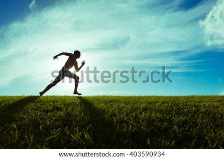Young male running outdoors.  - stock photo