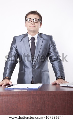 Young male secretary at the reception. - stock photo