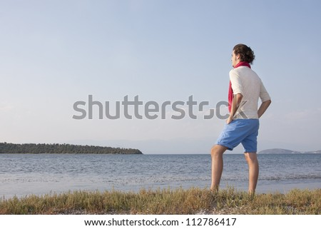 Young male standing at sea side