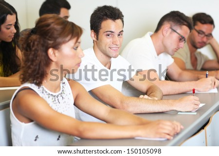Young male student in the classroom - stock photo