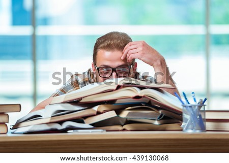 Young male student preparing for high school exams - stock photo