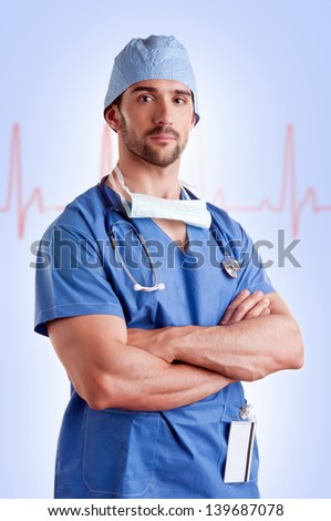 Young male surgeon with scrubs and a stethoscope, with a EKG graph behind him - stock photo