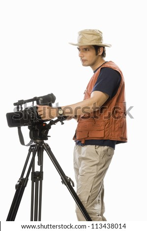 Young male videographer holding a videography camera - stock photo