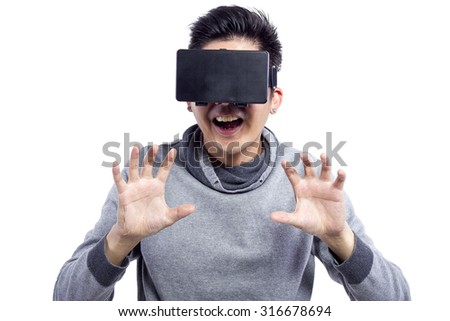 Young male watching 1st Person Perspective 3d VR movies   He is using virtual reality glasses. - stock photo