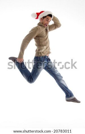young male wearing christmas hat and jumping on an isolated background - stock photo