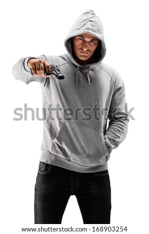 Young male with hood over his head holding a gun, symbolizing crime isolated against white background - stock photo