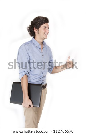 Young male with laptop making success sign