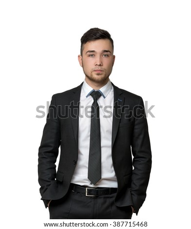 Young man a business suit, hands in his pockets, isolated on white background