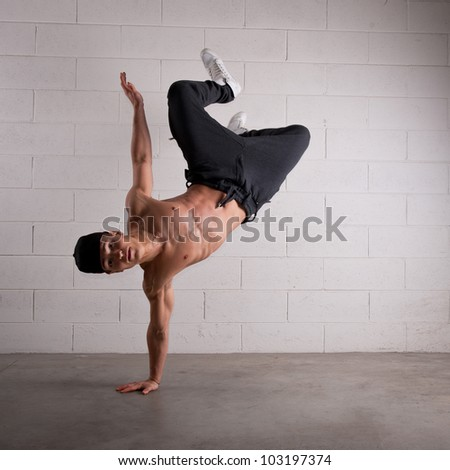 Young man acrobatic dancing. Free style. - stock photo