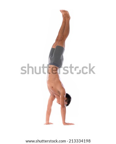 Young man acrobatics gymnastic doing a handstand studio ,athletic sportsman