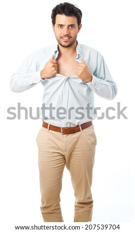 young man acting like a super hero and tearing his shirt off on a white background - stock photo