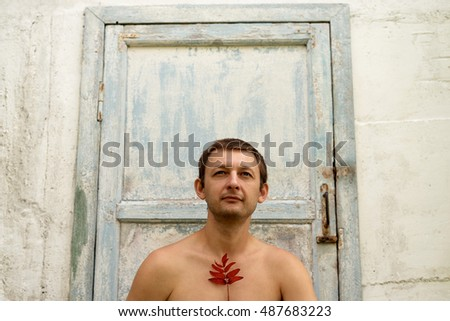 Young man against a shabby door background