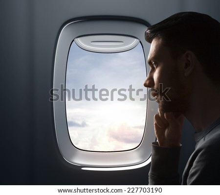 Young man and airplane - stock photo