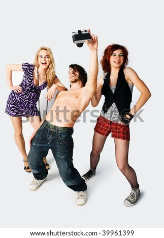 Young man and beautiful girls shooting at the studio - stock photo