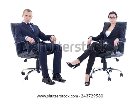 young man and beautiful woman in business suits sitting on office chairs isolated on white background - stock photo