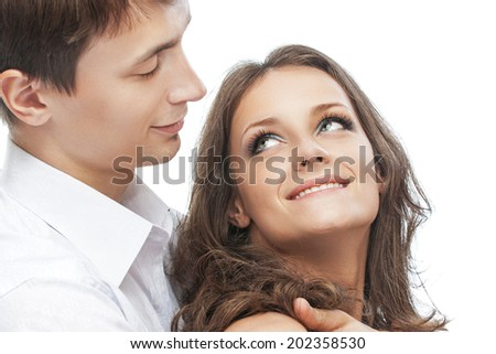 Young man and his beloved, on white background. - stock photo
