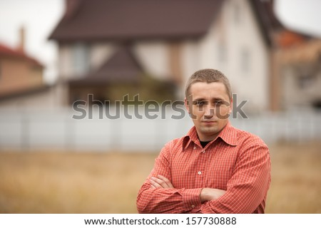 young man and his house - stock photo