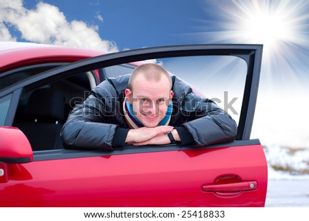 young man and his new car - stock photo