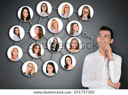 Young man and many friends connected - stock photo