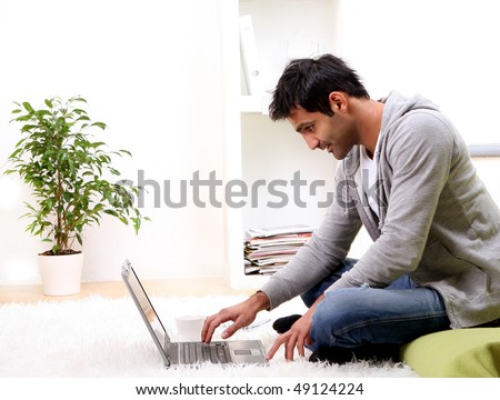 young man and news at the home - stock photo