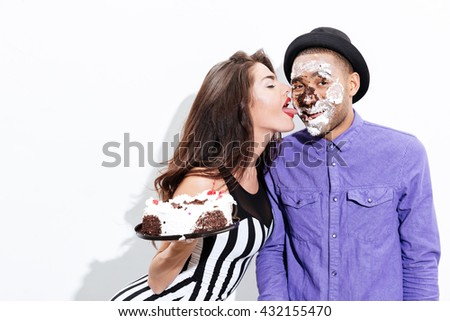 Young man and pretty girl joking isolated on the white background