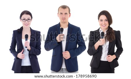 young man and two woman reporters with microphones isolated on white background - stock photo