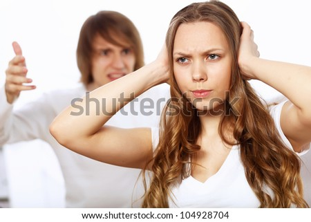 Young man and woman angry and conflicting - stock photo
