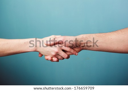 Young man and woman are shaking hands