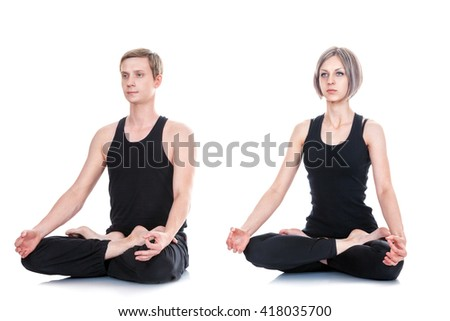 Young man and woman doing yoga and meditating in lotus position isolated on white background - stock photo