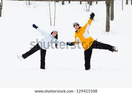Young man and woman during their outing with snowboards