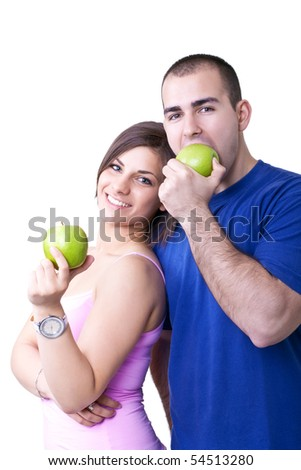 young man and woman eating healthy green apples