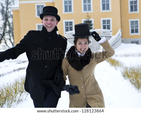 Young man and woman greeting happily coming guests