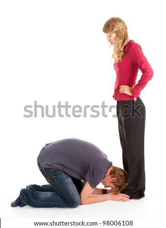 young man and woman, he kneeling before she, white background