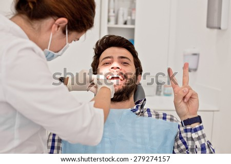 young man and woman in a dental examination at dentist