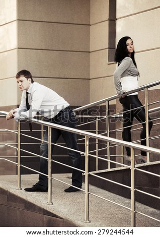 Young man and woman in conflict - stock photo