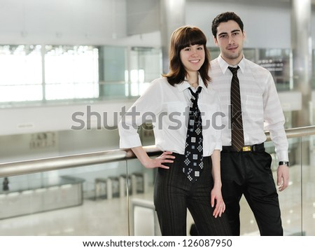 young man and woman  in  office environment
