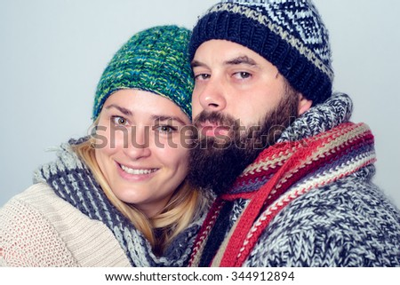 young man and woman in winter dress  - stock photo