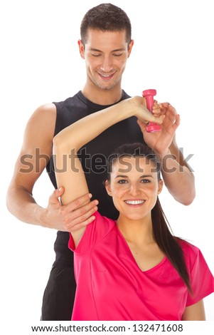 Young man and woman lifting weights. Isolated on white/ Woman with her personal fitness trainer exercising with weights - stock photo