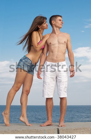 Young man and woman on seashore