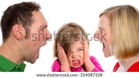 young man and  woman screaming in front of little girl - stock photo