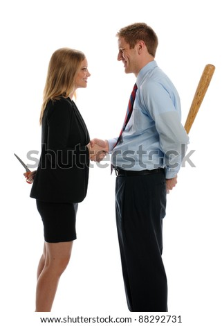 Young Man and Woman shaking hands and hiding weapons isolated on a white background - stock photo