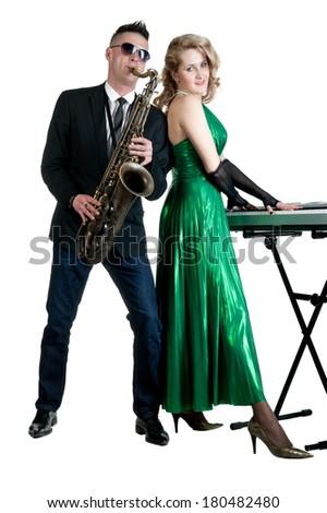 Young man and woman with musical instruments saxophone and synthesizer on a white background isolated
